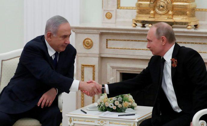 FILE PHOTO: Russian President Vladimir Putin and Israeli Prime Minister Benjamin Netanyahu shake hands during a meeting at the Kremlin in Moscow, Russia May 9, 2018. Sergei Ilnitsky/Pool/File Photo via REUTERS
