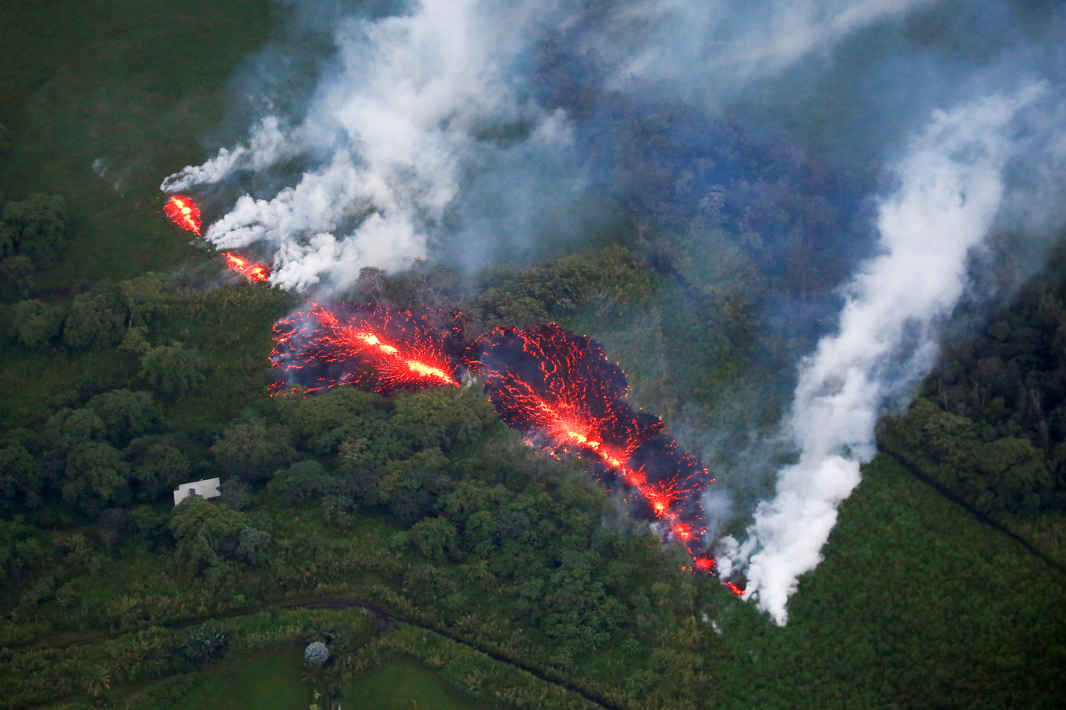 Lava erupts from a fissure east of the Leilani Estates subdivision during ongoing eruptions of the Kilauea Volcano in Hawaii, U.S., May 13, 2018. REUTERS/Terray Sylvester