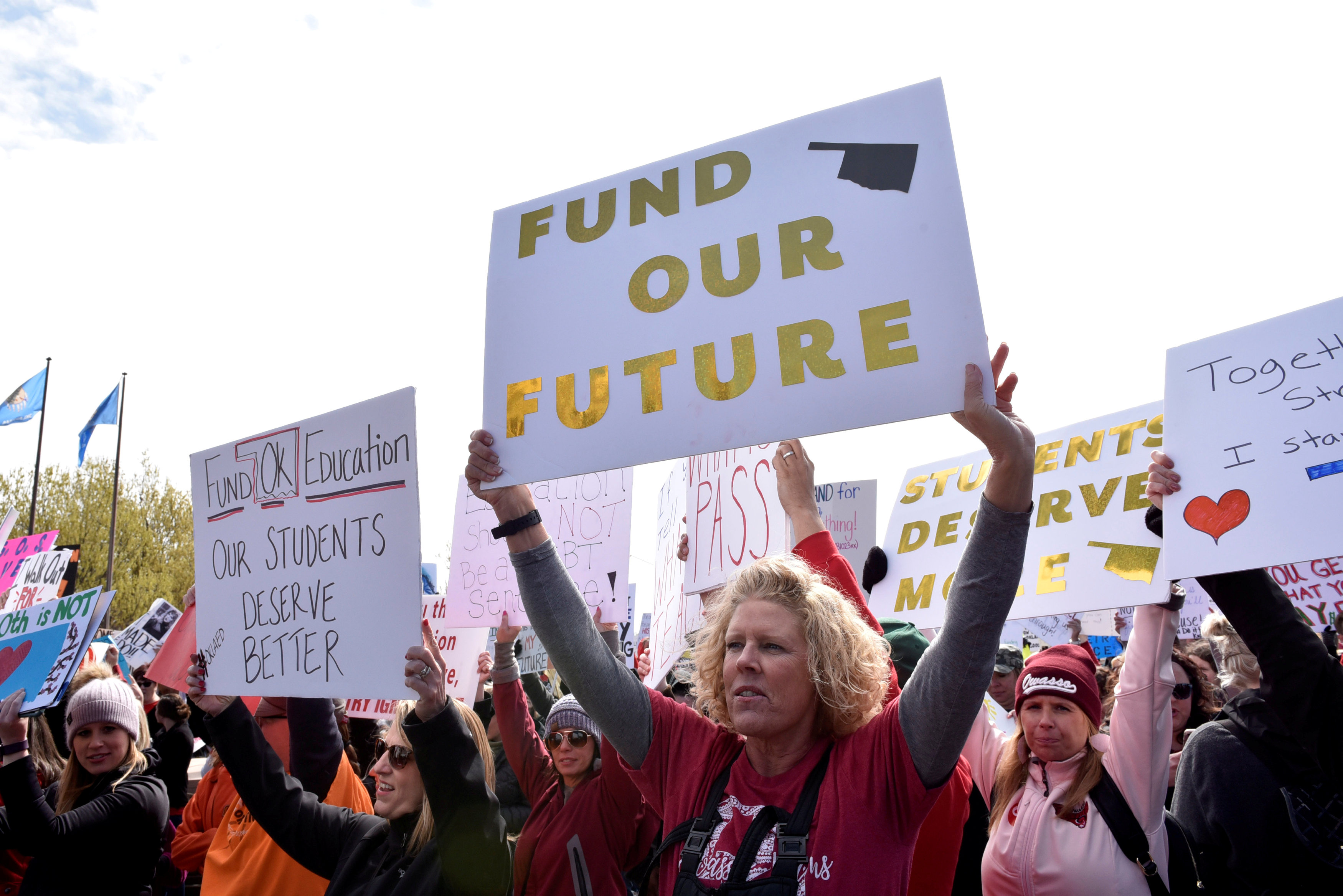 FILE PHOTO: Teachers rally outside the state Capitol on the second day of a teacher walkout to demand higher pay and more funding for education in Oklahoma City, Oklahoma, U.S., April 3, 2018. REUTERS/Nick Oxford/File Photo