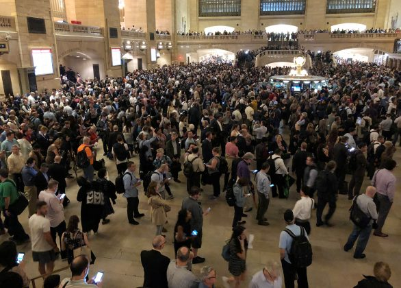 Commuters wait as service was temporarily suspended on all Metro North lines at Grand Central Terminal due to storms in Manhattan, New York, May 15, 2018. REUTERS/Herbert Lash