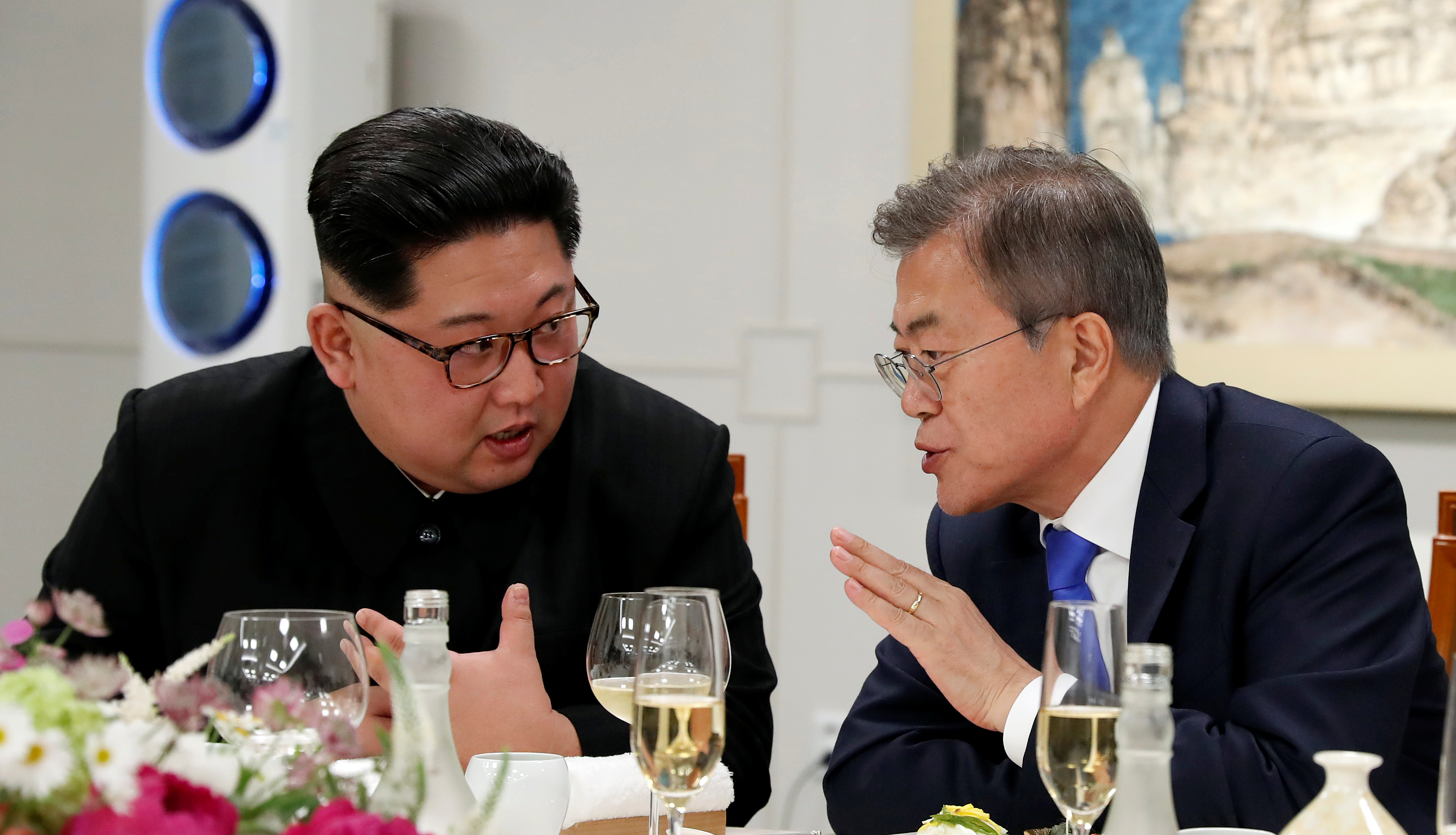 FILE PHOTO - South Korean President Moon Jae-in and North Korean leader Kim Jong Un attend a banquet on the Peace House at the truce village of Panmunjom inside the demilitarized zone separating the two Koreas, South Korea, April 27, 2018. Korea Summit Press Pool/Pool via Reuters