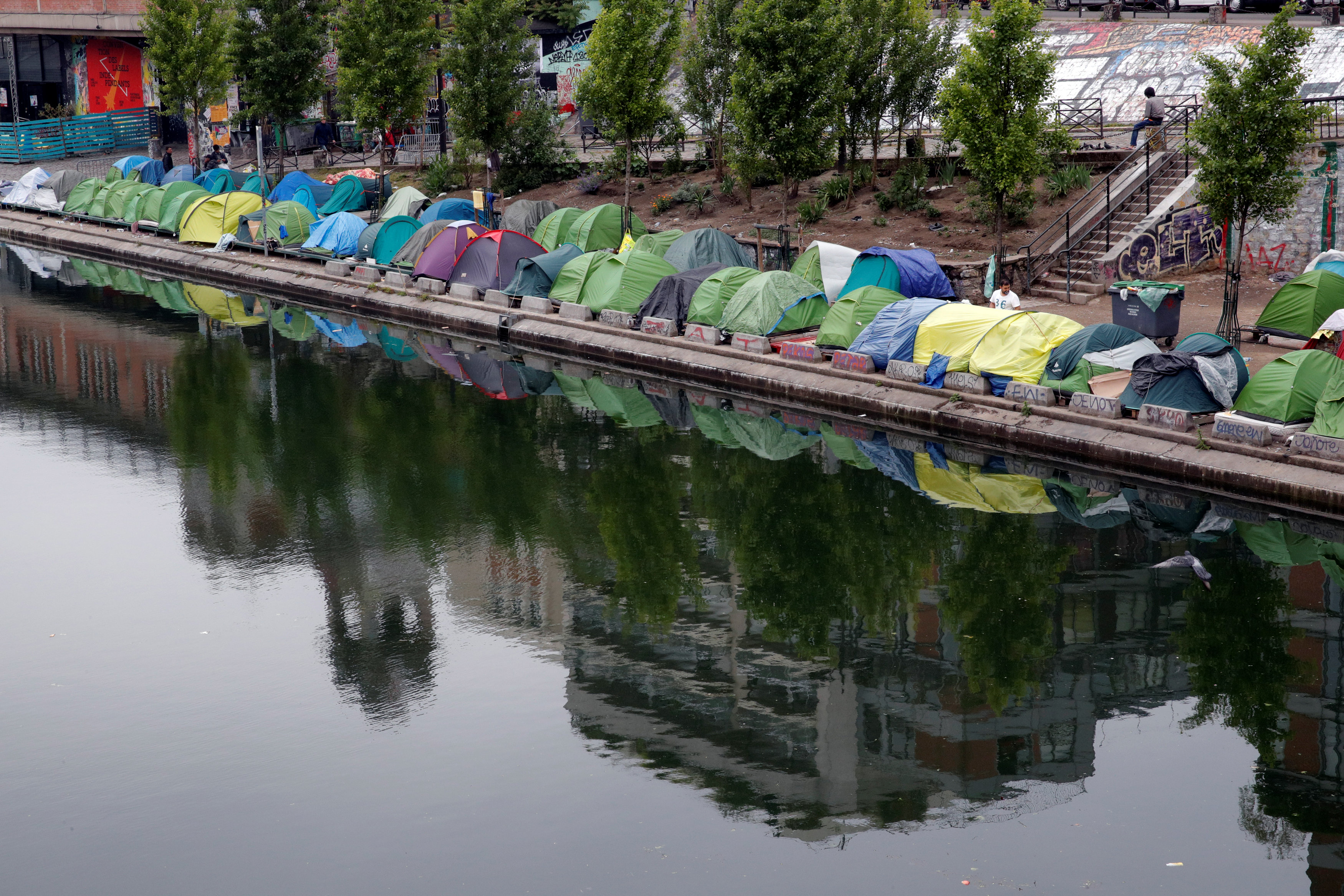 Tents where migrants live in a makeshift camp are seen on the Quai de Valmy of the canal Saint-Martin in Paris, France, May 15, 2018. Picture taken May 15, 2018. REUTERS/Philippe Wojazer