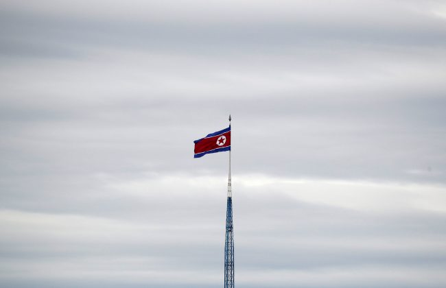 FILE PHOTO: A North Korean flag flutters on top of a 160-metre tower in North Korea's propaganda village of Gijungdong, in this picture taken from the Tae Sung freedom village near the Military Demarcation Line (MDL), inside the demilitarised zone separating the two Koreas, in Paju, South Korea, April 24, 2018. REUTERS/Kim Hong-Ji