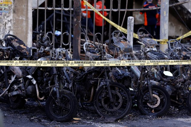 FILE PHOTO: Burned motorcycles are seen outside a church, one of the three hit by suicide bombers in Surabaya, Indonesia May 13, 2018. REUTERS/Beawiharta