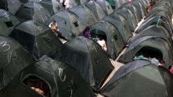 People rest in tents set up at the municipal coliseum after the Colombian government ordered the evacuation of residents living along the Cauca river, as construction problems at a hydroelectric dam prompted fears of massive flooding, in Valdivia, Colombia May 17, 2018. REUTERS/Fredy Buile