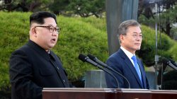 FILE PHOTO: North Korean leader Kim Jong Un and South Korean President Moon Jae-in deliver a statement at the truce village of Panmunjom inside the demilitarized zone separating the two Koreas, South Korea, April 27, 2018. Korea Summit Press Pool/Pool via Reuters
