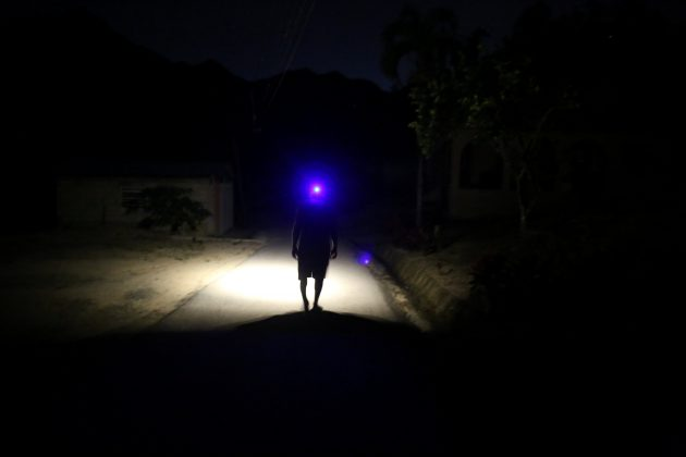 Jose Alvarez, 60, uses a head lamp while walking in the dark as the island's fragile power system is still reeling from the devastation wrought by Hurricane Maria eight months ago, in Jayuya, Puerto Rico May 10, 2018. REUTERS/Alvin Baez