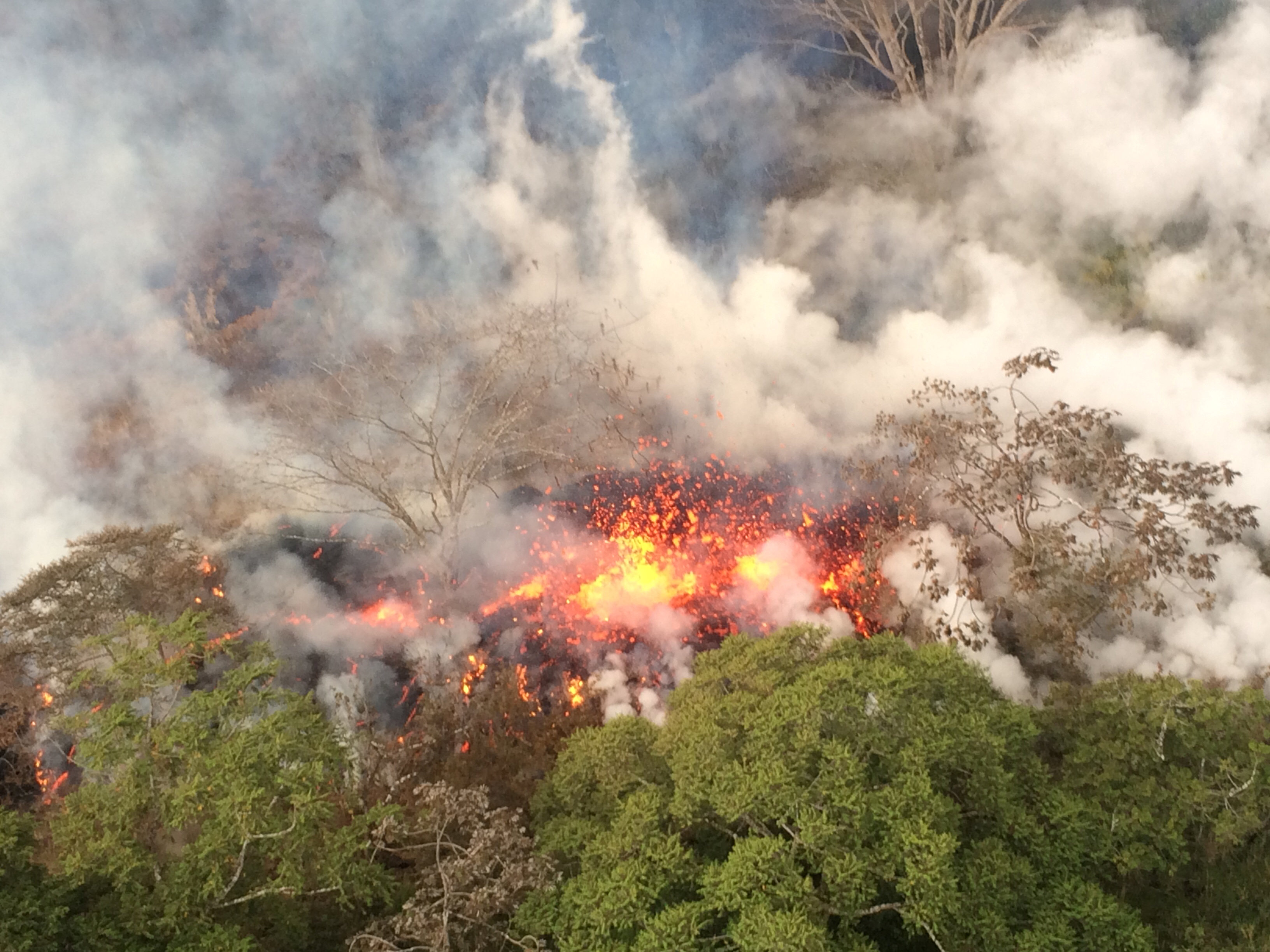 Lava spattering area from an area between fissures 16 and 20 is seen in Hawaii, U.S. May 16, 2018. Picture taken on May 16, 2018. USGS/Handout via REUTERS