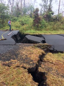 A geologist inspects cracks on a road in Leilani Estates, following eruption of Kilauea volcano, Hawaii May 17, 2018. United States Geological Survey (USGS)/Handout via REUTERS