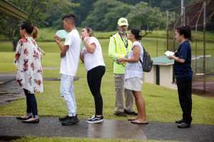 People wait in line for free dust masks in Keaau to protect themselves from volcanic ash during ongoing eruptions of the Kilauea Volcano in Hawaii, U.S., May 17, 2018. REUTERS/Terray Sylvester