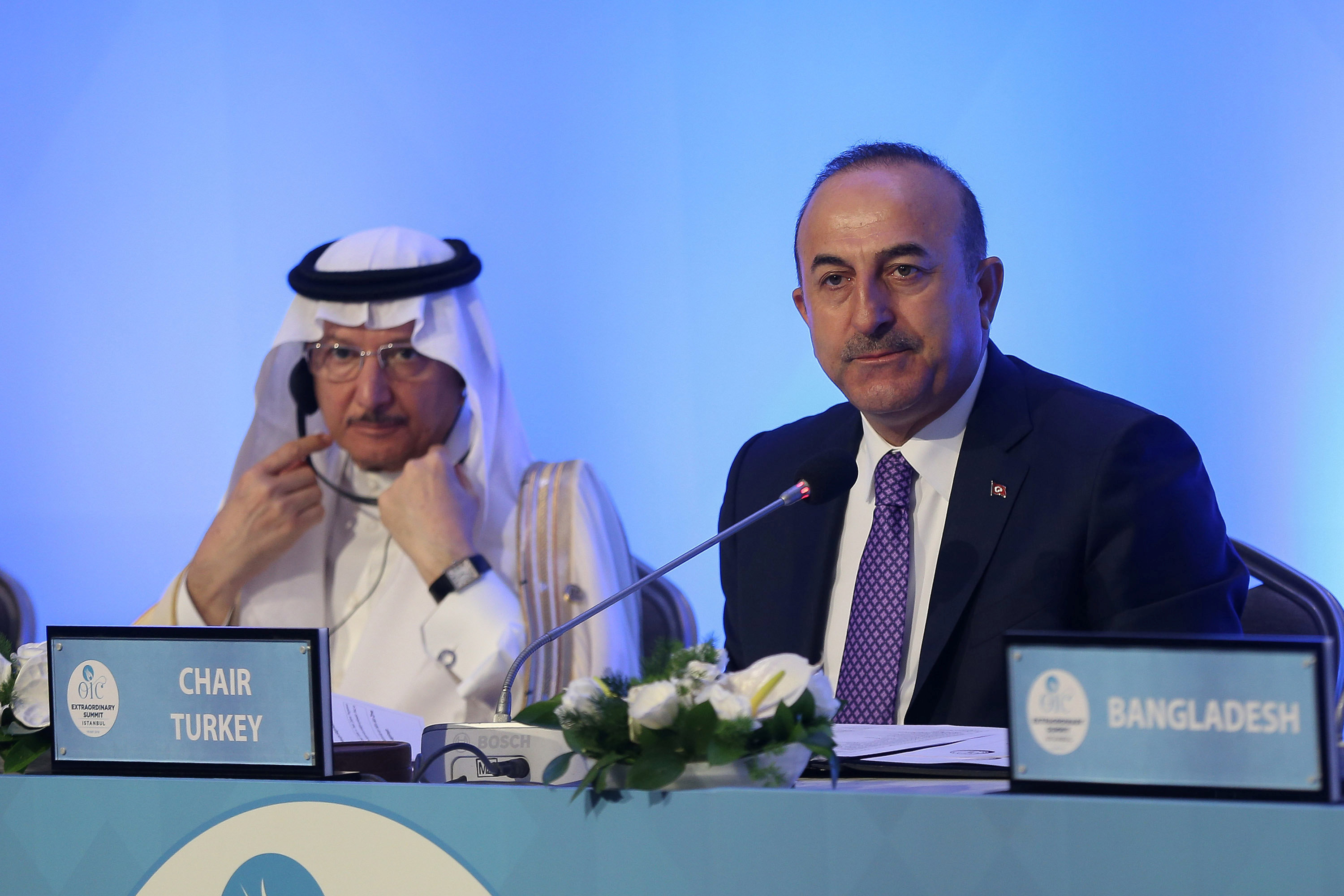 Turkish Foreign Minister Mevlut Cavusoglu and Secretary General of Organization of Islamic Cooperation (OIC) Yousef bin Ahmad Al-Othaimeen are seen during a meeting of the OIC Foreign Ministers Council in Istanbul, Turkey May 18, 2018. Hudaverdi Arif Yaman/Pool via Reuters