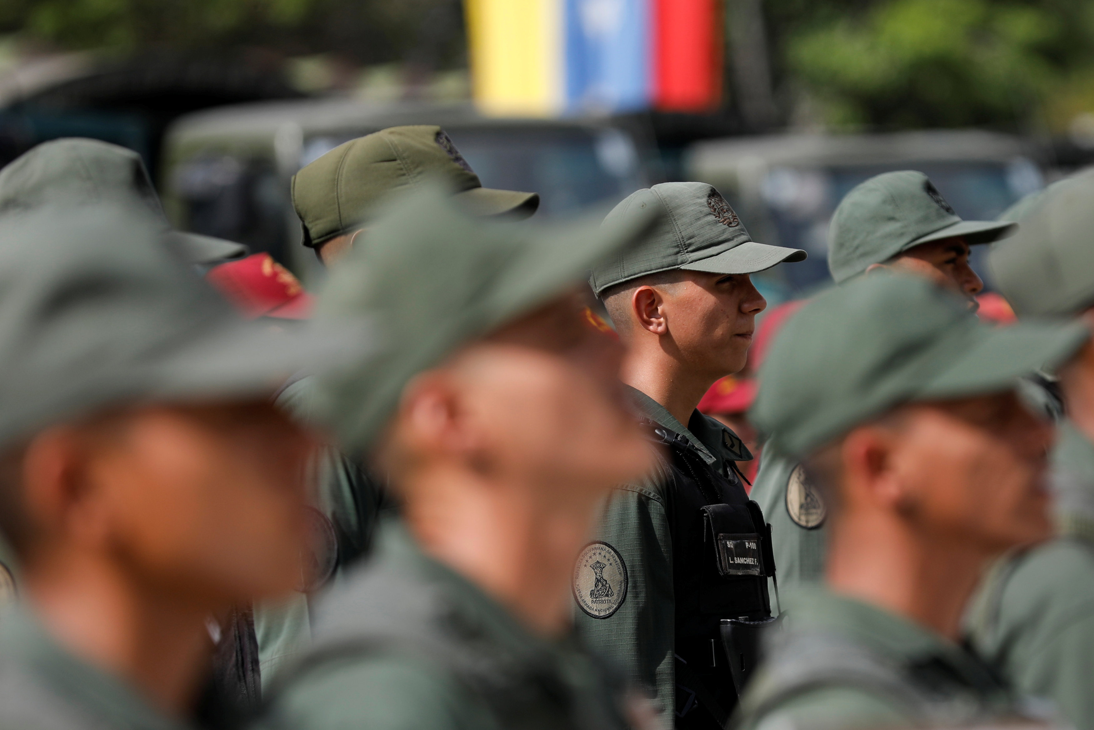 Soldiers stand in formation before the start of a ceremony to kick off the distribution of security forcers and voting materials to be used in the upcoming presidential elections, at Fort Tiuna military base in Caracas, Venezuela May 15, 2018. Pictures taken on May 15, 2018. REUTERS/Carlos Jasso