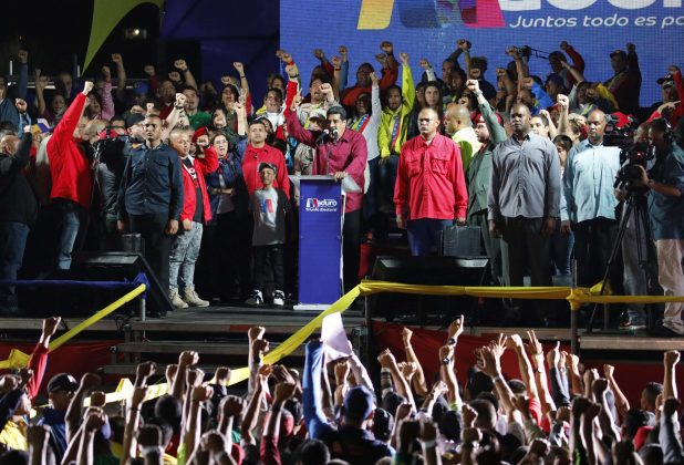 Venezuela's President Nicolas Maduro raises a finger as he is surrounded by supporters while speaking during a gathering after the results of the election were released, outside of the Miraflores Palace in Caracas, Venezuela, May 20, 2018. REUTERS/Carlos Garcia Rawlins