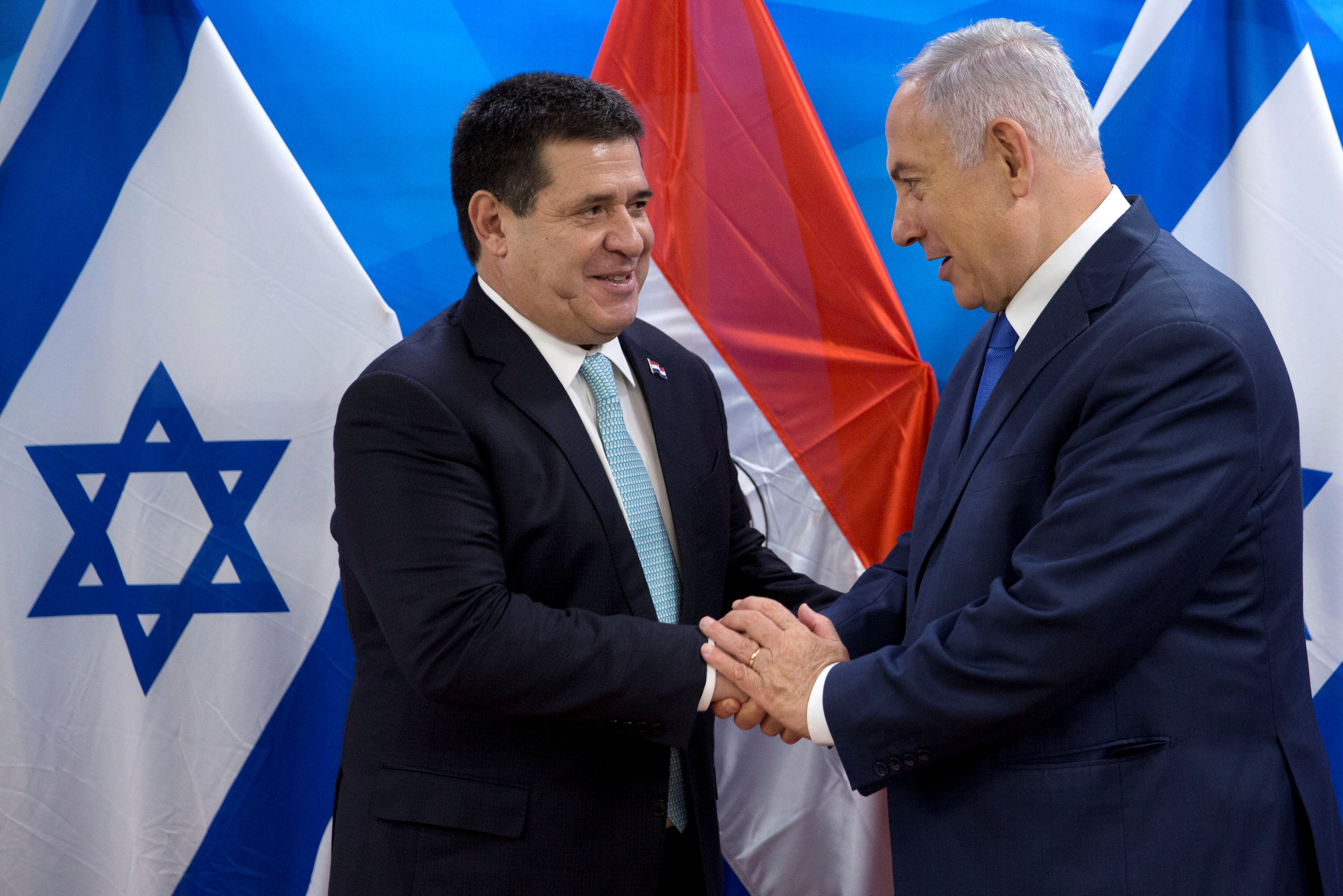 Paraguayan President Horacio Cartes shakes hands with Israeli Prime Minister Benjamin Netanyahu during a meeting at the Prime Minister's office in Jerusalem, following the dedication ceremony of the embassy of Paraguay in Jerusalem, May 21, 2018. Sebastian Scheiner/Pool via Reuters