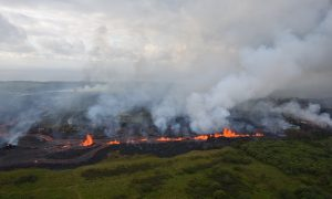 Lava flows downhill in this helicopter overflight image of Kilauea Volcano's lower East Rift zone during ongoing eruptions in Hawaii, U.S. May 19, 2018. USGS/Handout via REUTERS