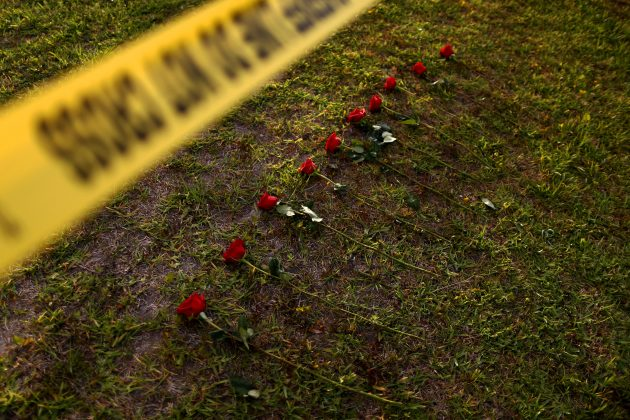 Ten roses are left in memory of the victims killed in a shooting at the Santa Fe High School in Santa Fe, Texas, U.S., May 20, 2018. REUTERS/Jonathan Bachman