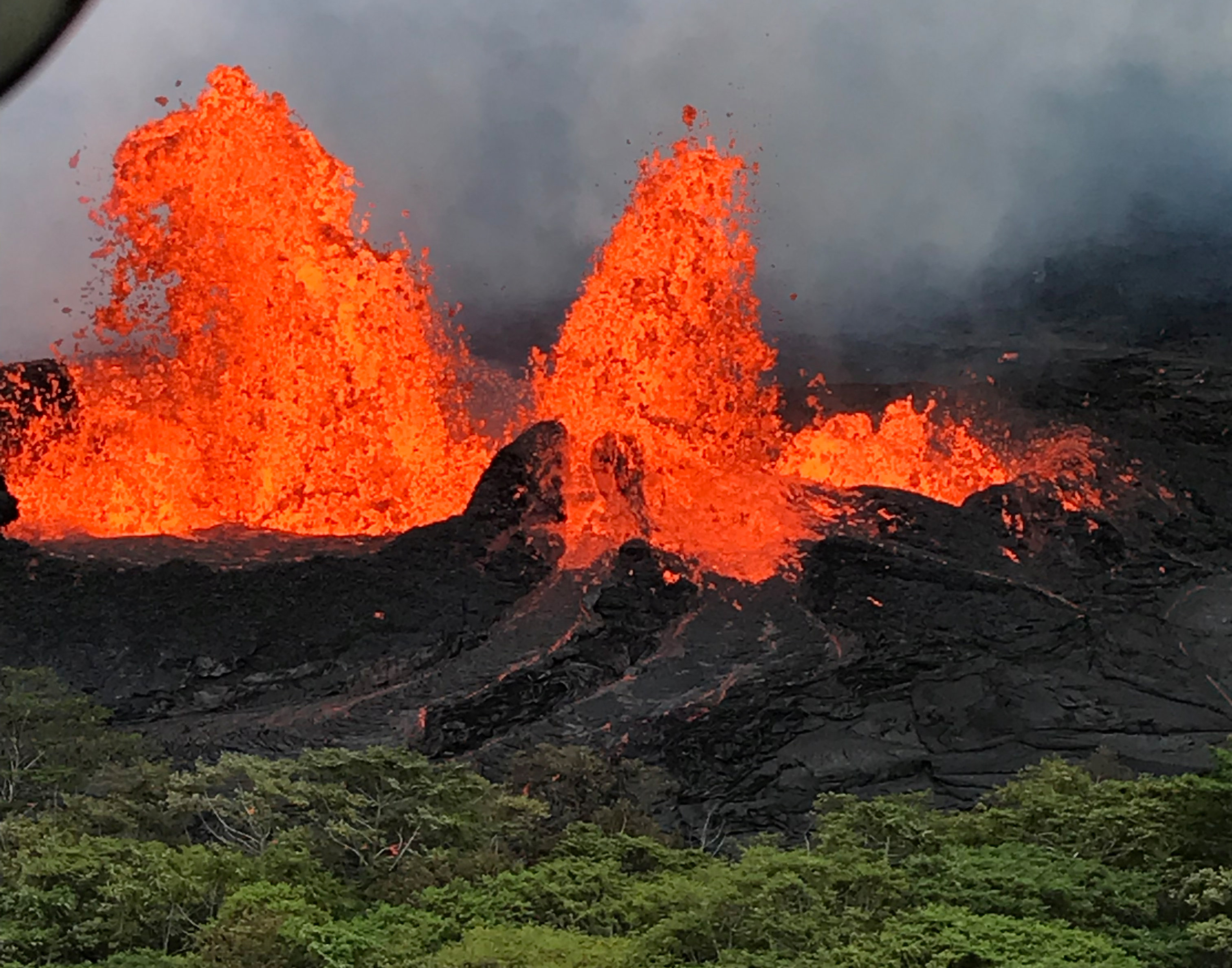 A lava fountain is observed from a helicopter flight over the Fissure 22 in Kilauea Volcano's Lower East Rift Zone during ongoing eruptions of the Kilauea Volcano in Hawaii, U.S. May 21, 2018. Picture taken on May 21, 2018. USGS/Handout via REUTERS