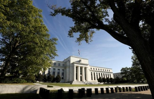 FILE PHOTO: The Federal Reserve headquarters in Washington, U.S., September 16, 2015. REUTERS/Kevin Lamarque/File Photo