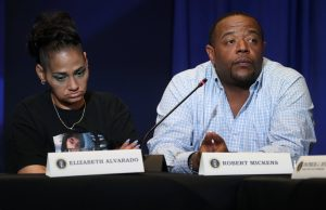 Elizabeth Alvarado and Robert Mickens, whose daughter Nisa Mickens was killed by MS-13 gang members, participate in a roundtable on immigration and the gang MS-13 attended by U.S. President Donald Trump at the Morrelly Homeland Security Center in Bethpage, New York, U.S., May 23, 2018. REUTERS/Kevin Lamarque