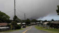 A volcanic ash cloud hovers in the distance over the small town of Pahala during the eruption of the Kilauea Volcano in Pahala, Hawaii, U.S., May 23, 2018. REUTERS/Marco Garcia
