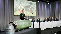 Dutch police officer Wilbert Paulissen, head of the National Crime Squad, is pictured next to a damaged missile as he presents interim results in the ongoing investigation of the 2014 MH17 crash that killed 298 people over eastern Ukraine, during a news conference by members of the Joint Investigation Team, comprising the authorities from Australia, Belgium, Malaysia, the Netherlands and Ukraine, in Bunnik, Netherlands, May 24, 2018. REUTERS/Francois Lenoir