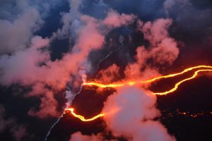 Lava flows are seen entering the sea along the coastline during ongoing eruptions of the Kilauea Volcano May 23, 2018. USGS/J. Ozbolt, Hilo Civil Air Patrol/Handout via REUTERS