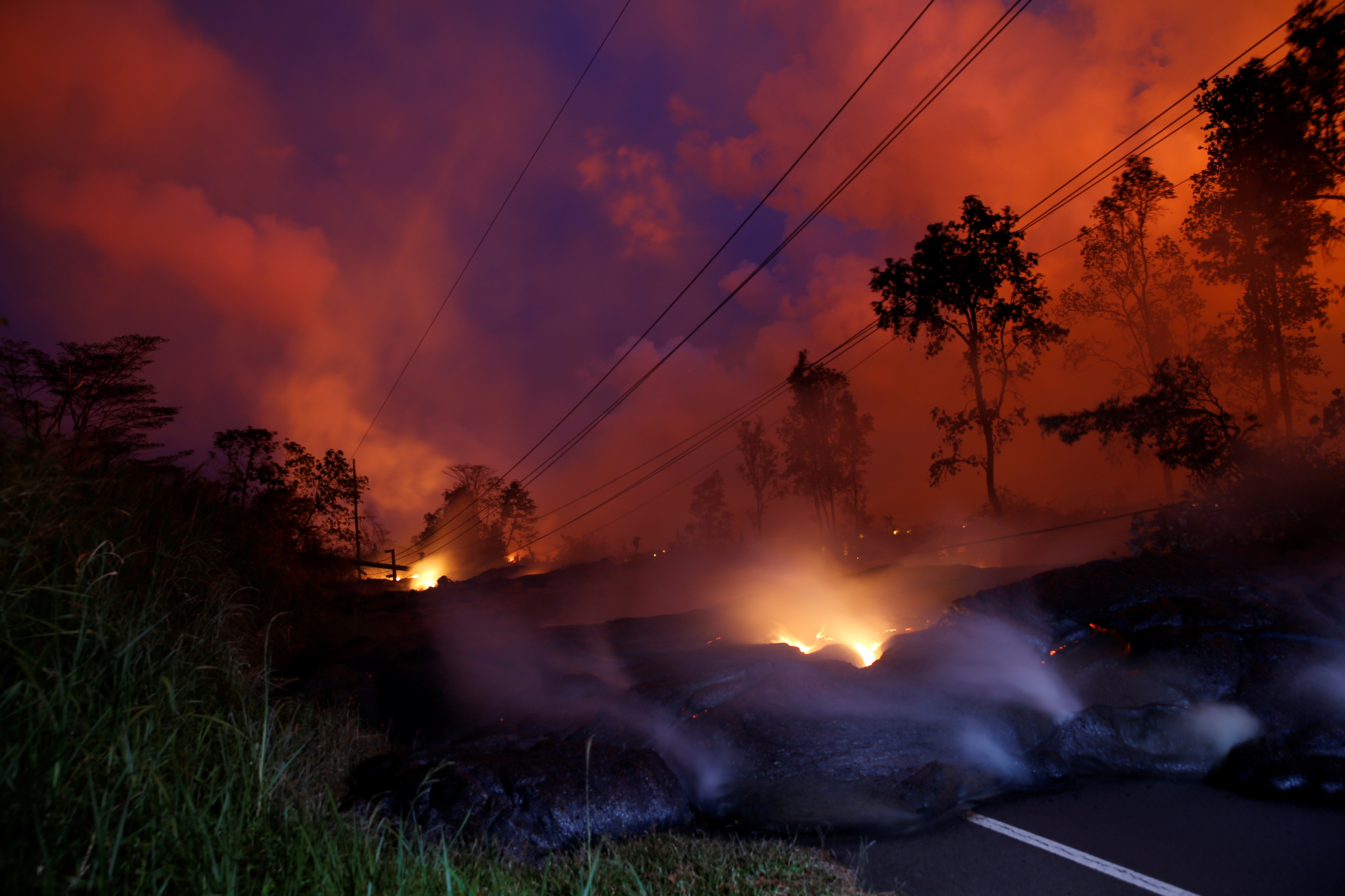 Volcanic gases rise from the Kilauea lava flow that crossed Pohoiki Road near Highway 132, near Pahoa, Hawaii, U.S., May 28, 2018. REUTERS/Marco Garc