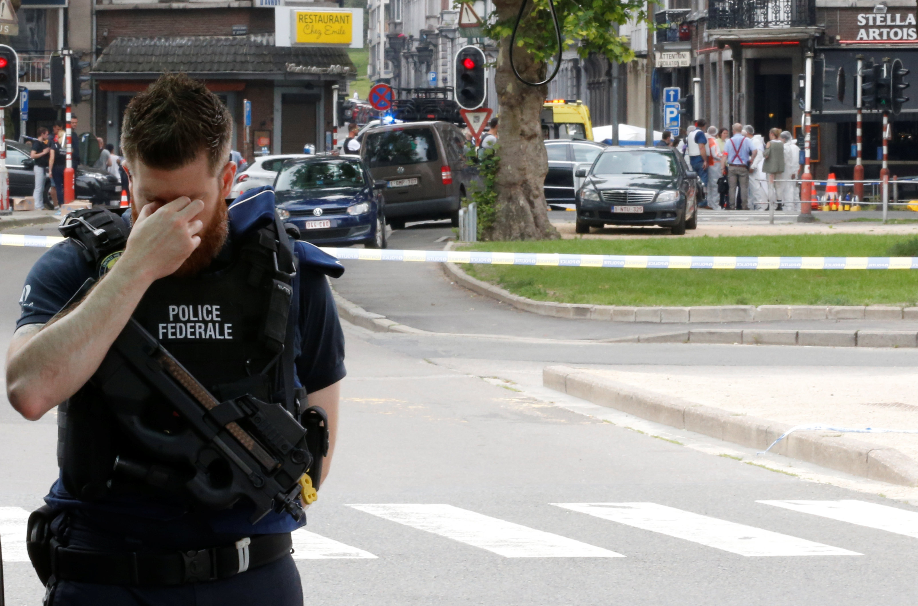 A police officer is seen on the scene of a shooting in Liege, Belgium, May 29, 2018. REUTERS/Francois Lenoir
