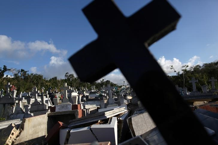Graves destroyed during Hurricane Maria in September 2017, are seen at a cemetery, in Lares, Puerto Rico February 8, 2018. REUTERS/Alvin Baez