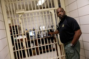Warden Dennis Grimes opens the doors to holding cells of the East Baton Rouge Parish Prison in Baton Rouge, Louisiana March 5, 2018. Picture taken March 5, 2018. REUTERS/Shannon Stapleton