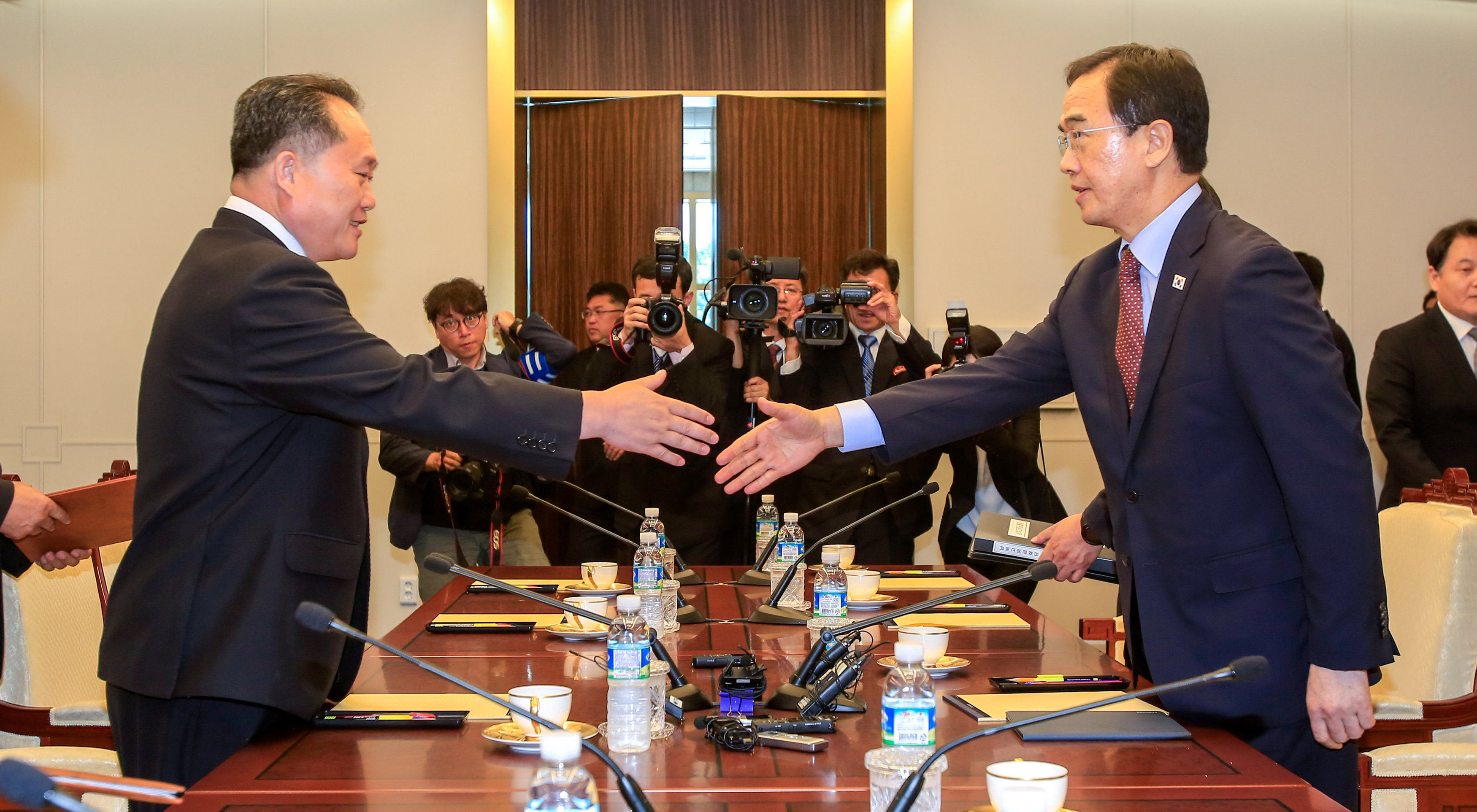 South Korean Unification Minister Cho Myoung-gyon shakes hands with his North Korean counterpart Ri Son Gwon during their meeting at the truce village of Panmunjom, South Korea, June 1, 2018. Yonhap via REUTERS