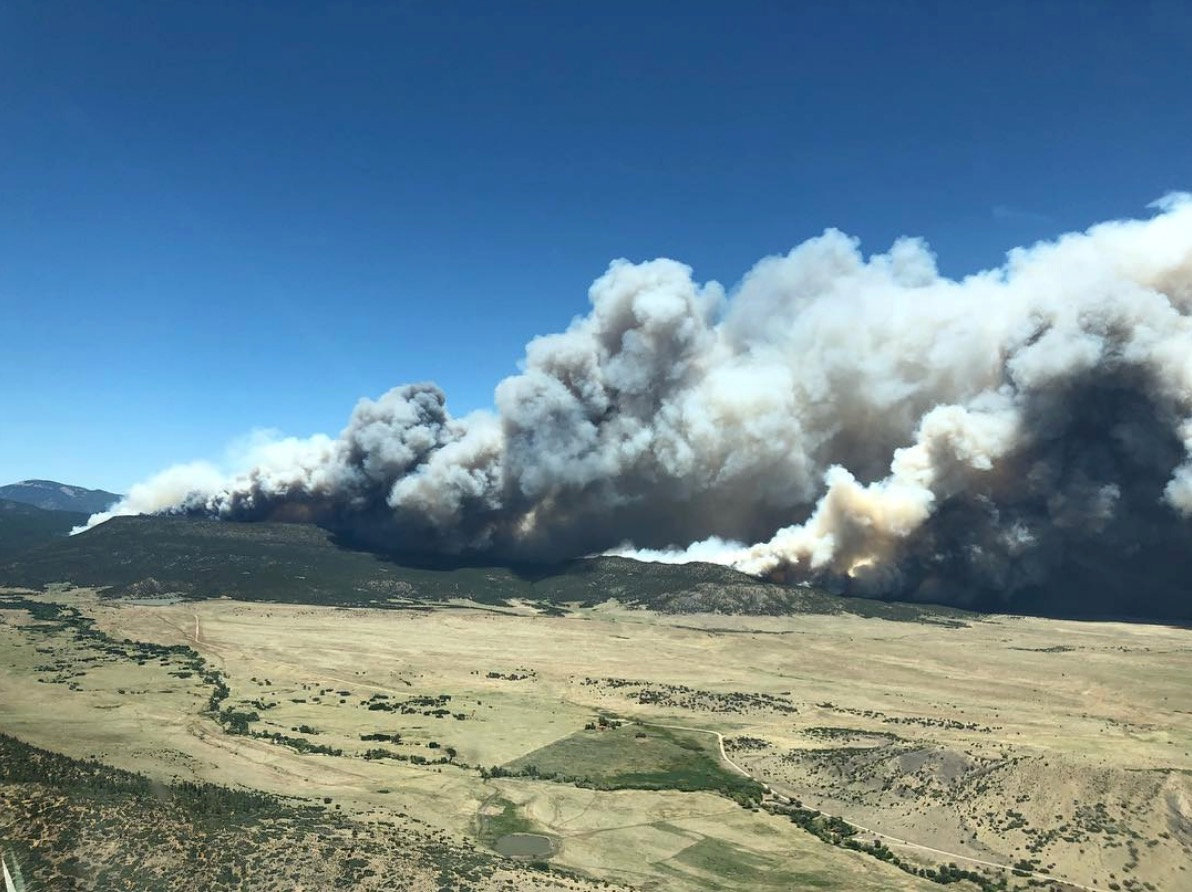 FILE PHOTO: Smoke is seen from a fire in this aerial shot above Cimarron, New Mexico, U.S., June 1, 2018 in this picture obtained from social media on June 2, 2018. Justin Hawkins/via REUTERS