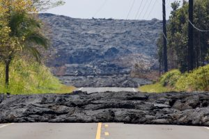 Lava covers a road in Pahoa during ongoing eruptions of the Kilauea Volcano in Hawaii, U.S., June 3, 2018. REUTERS/Terray Sylvester