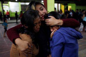 Women react inside a shelter after Fuego volcano erupted violently in San Juan Alotenango, Guatemala June 3, 2018. REUTERS/Luis Echeverria