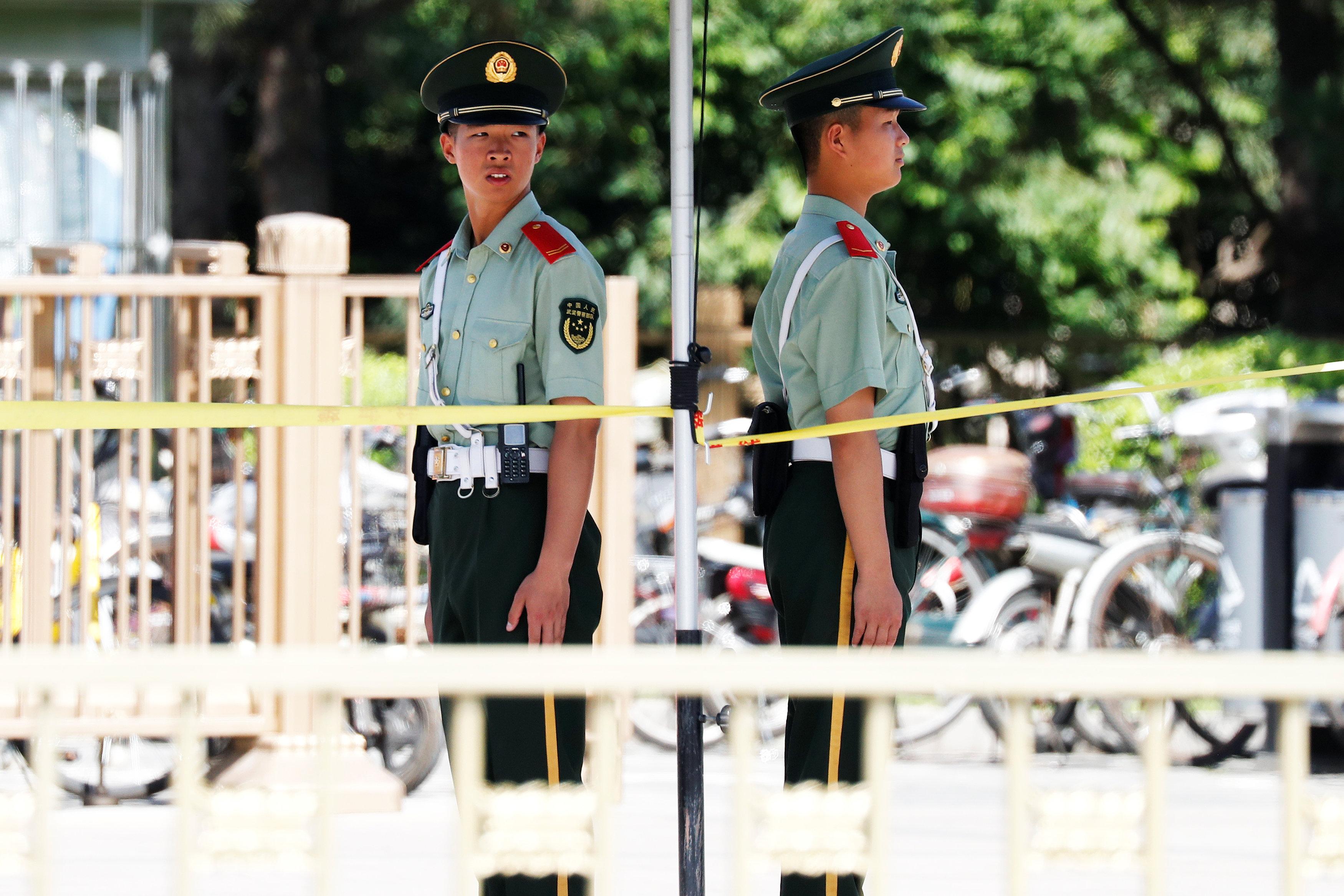 Paramilitary policemen take position near Beijing's Tiananmen Square, China June 4, 2018. REUTERS/Damir Sagolj
