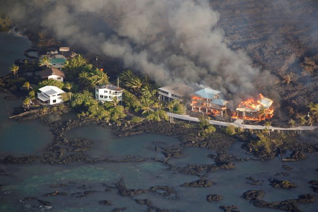 Lava destroys homes in the Kapoho area, east of Pahoa, during ongoing eruptions of the Kilauea Volcano in Hawaii, June 5, 2018. REUTERS/Terray Sylvester