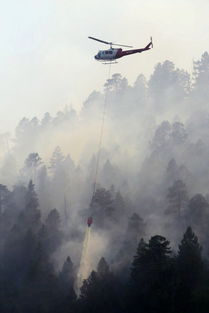A helicopter drops water on the 416 Fire near Durango, Colorado, U.S. in this June 4, 2018 handout photo obtained by Reuters June 5, 2018. La Plata County/Handout via REUTERS