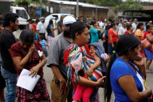 Residents wait in line to receive aid at an area affected by the eruption of Fuego volcano at the village of Sangre de Cristo in Chimaltenango, Guatemala, June 7, 2018. REUTERS/Jose Cabezas