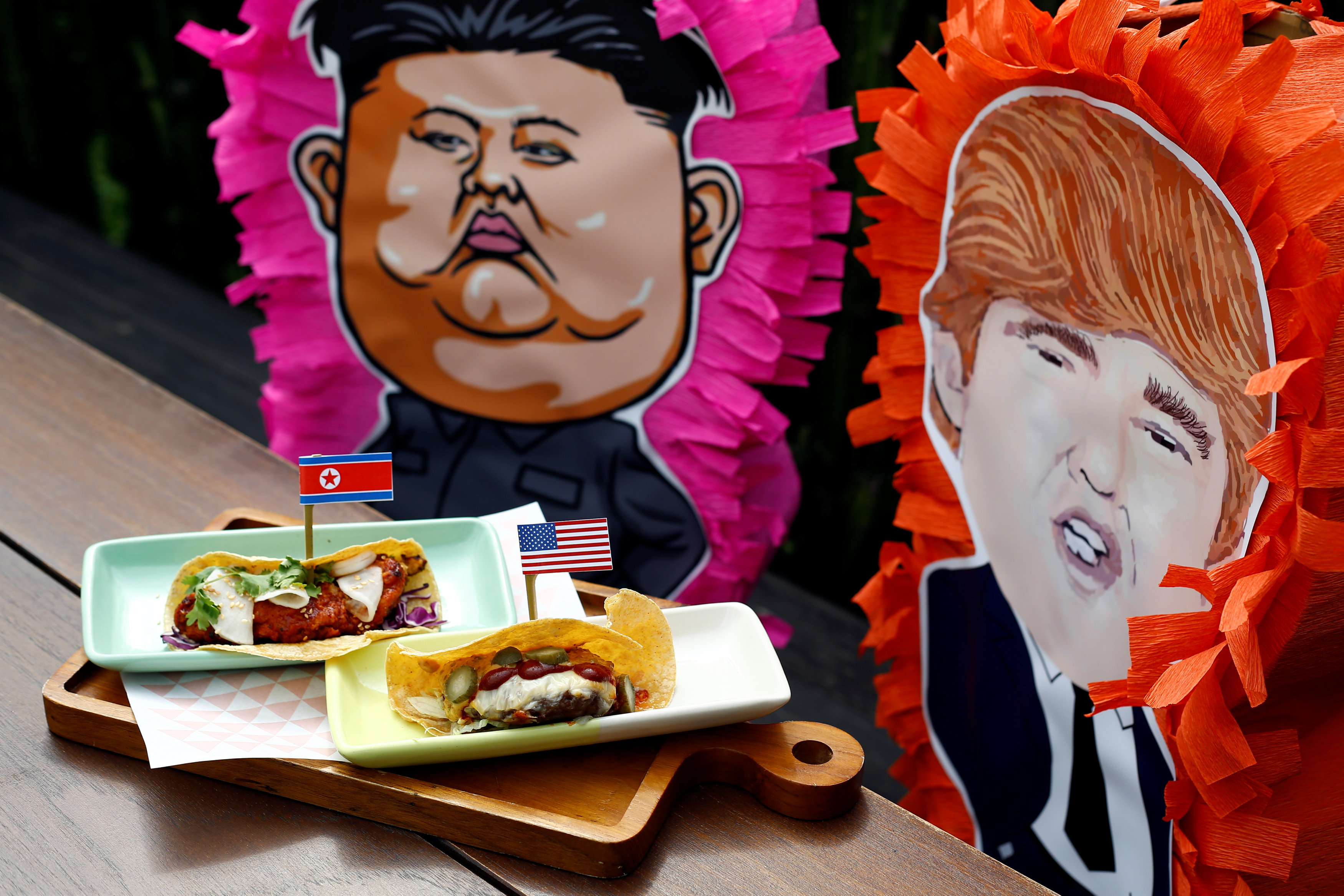 The Rocket Man Taco and the El Trumpo Taco is pictured at Lucha Loco in Singapore June 8, 2018. REUTERS/Feline Lim