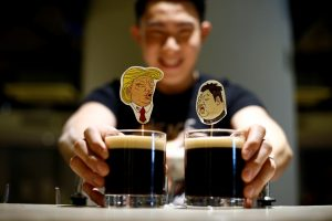 A bartender presents a pair of Donald Trump and Kim Jong Un cocktails called The Bromance at Hopheads Craft Beer Bar and Bistro in Singapore June 8, 2018. REUTERS/Feline Lim