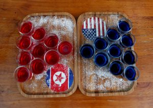 FILE PHOTO: Special red and blue shots offered at Escobar bar to mark the summit meeting between U.S. President Donald Trump and North Korean leader Kim Jong Un, are displayed on a table in Singapore June 4, 2018. REUTERS/Edgar Su/File Photo