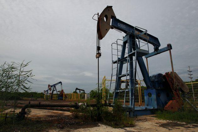 FILE PHOTO: Oil pumpjacks are seen in Lagunillas, Venezuela May 24, 2018. REUTERS/Isaac Urrutia
