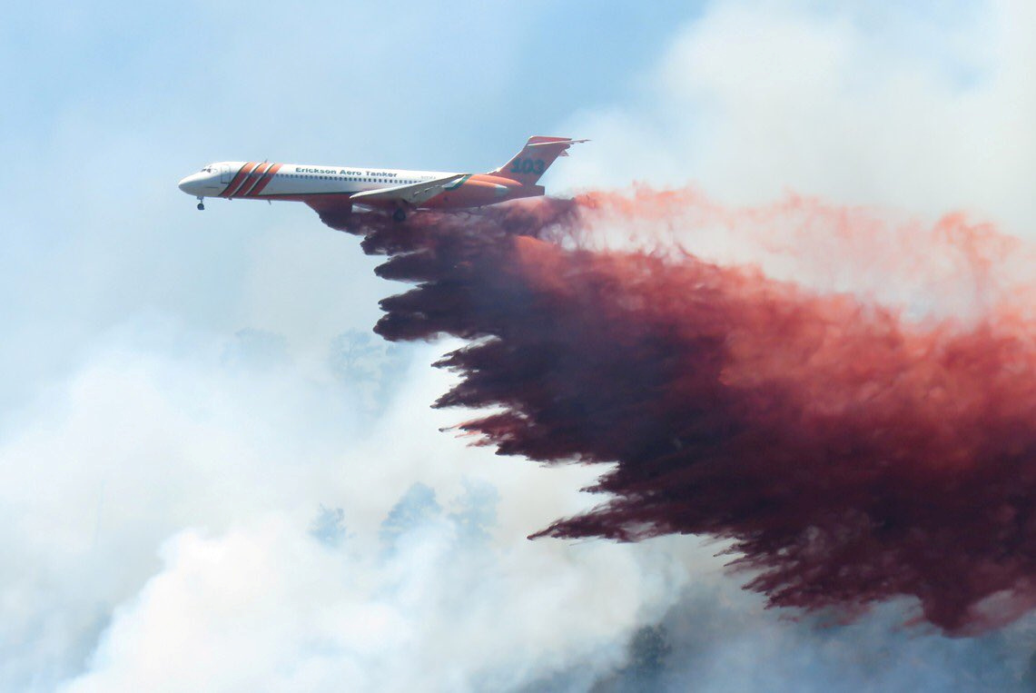 A plane drops fire-retardant chemicals on the 416 Fire near Durango, California, U.S. in this June 9, 2018 handout photo. La Plata County/Handout via REUTERS