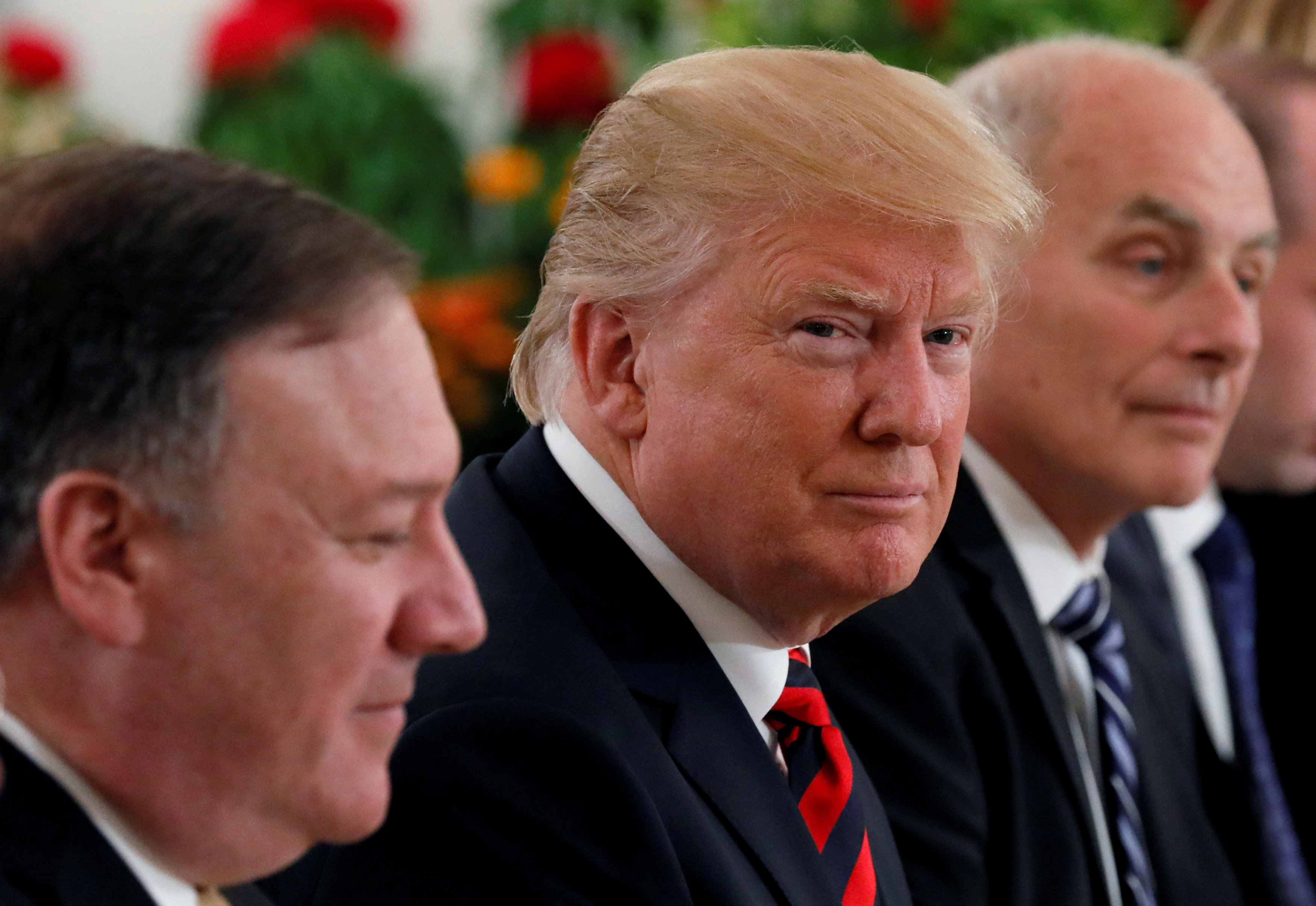 U.S. President Donald Trump flanked by Secretary of State Mike Pompeo and White House Chief of Staff John Kelly attend a lunch with Singapore's Prime Minister Lee Hsien Loong and officials at the Istana in Singapore June 11, 2018. REUTERS/Jonathan Ernst