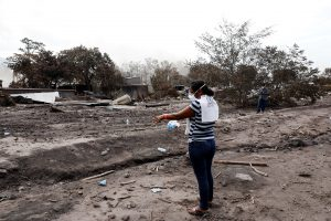 Eufemia Garcia, 48, who lost 50 members of her family during the eruption of the Fuego volcano, points the area where use to be her house in San Miguel Los Lotes Escuintla, June 9, 2018. Picture taken June 9, 2018. REUTERS/Carlos Jasso