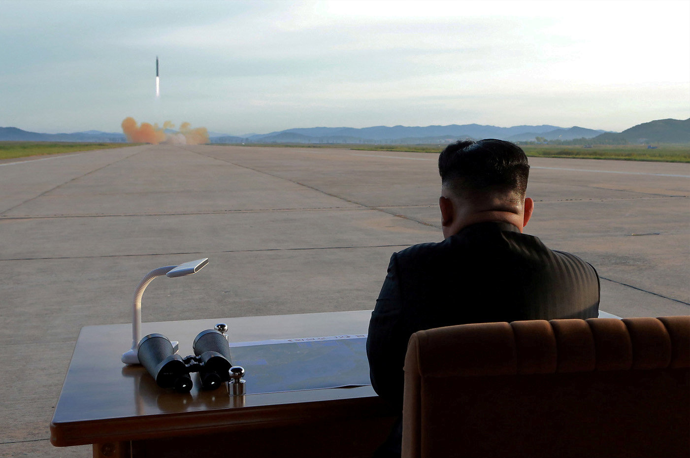 FILE PHOTO: North Korean leader Kim Jong Un watches the launch of a Hwasong-12 missile in this undated photo released by North Korea's Korean Central News Agency (KCNA) on September 16, 2017. KCNA via REUTERS