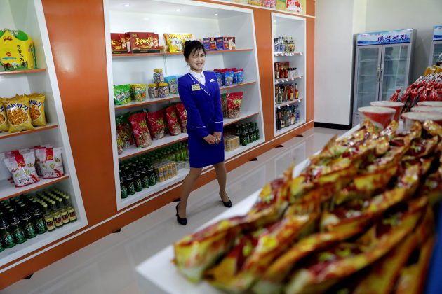 FILE PHOTO: A vendor is pictured in a shop in a newly constructed residential complex after its opening ceremony in Ryomyong street in Pyongyang, North Korea April 13, 2017. Picture taken April 13, 2017. REUTERS/Damir Sagolj/File Photo