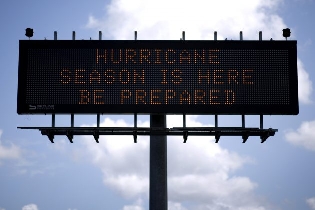 A traffic sign warns of hurricane season in Stowell, Texas, U.S., June 12, 2018. Picture taken June 12, 2018. REUTERS/Jonathan Bachman