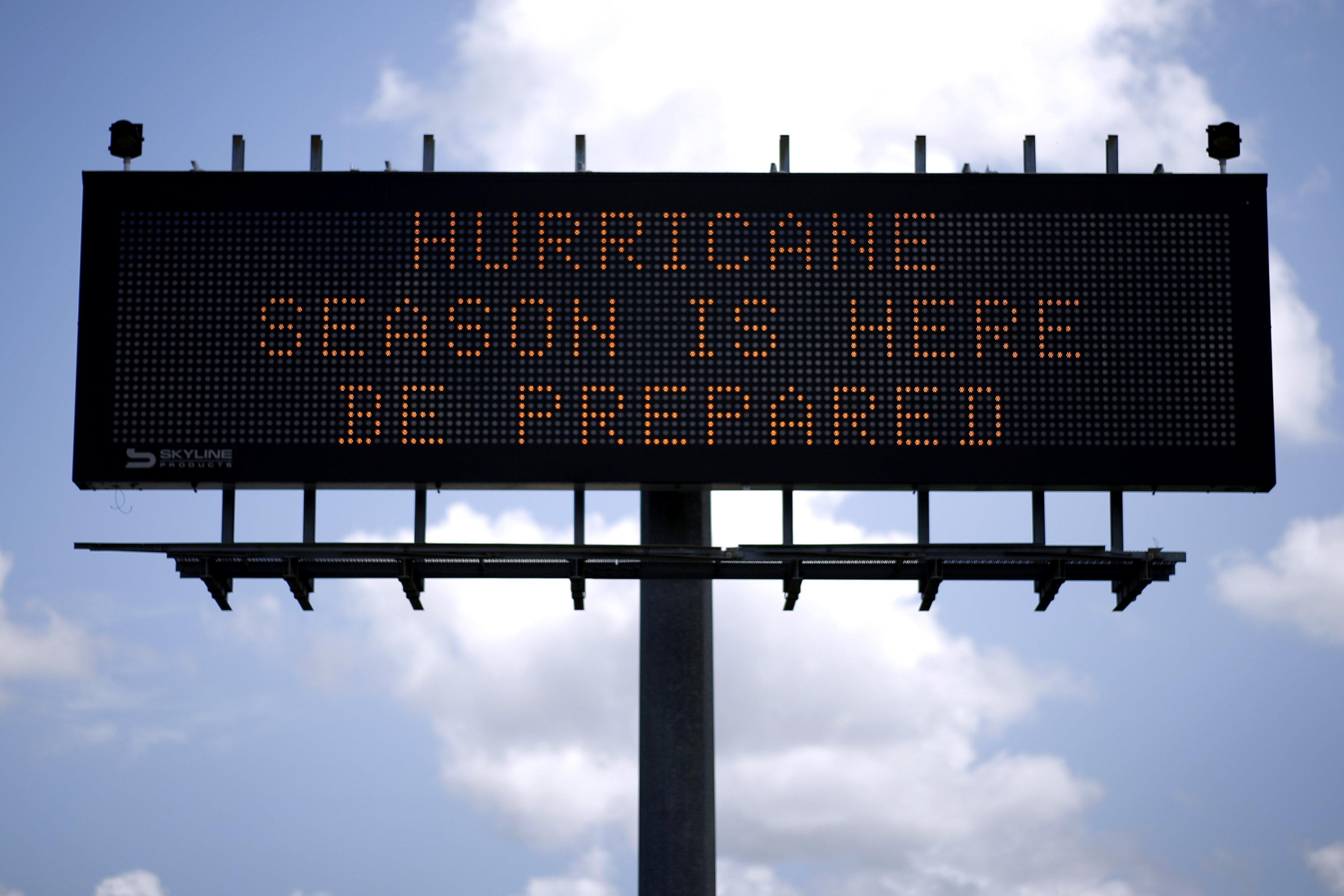 A traffic sign warns of hurricane season in Stowell, Texas, U.S., June 12, 2018. Picture taken June 12, 2018. REUTERS/Jonathan Bachman