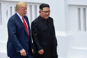U.S. President Donald Trump and North Korean leader Kim Jong Un walk in the Capella Hotel after their working lunch, on Sentosa island in Singapore June 12, 2018. Susan Walsh/Pool via Reuters